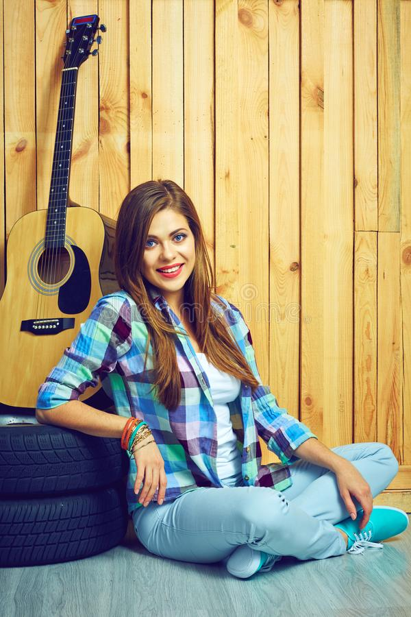 Smiling woman hipster style sitting on floor royalty free stock images