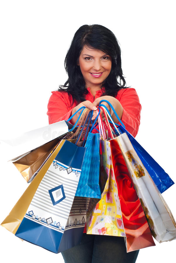 Smiling woman hold many shopping bags royalty free stock photos