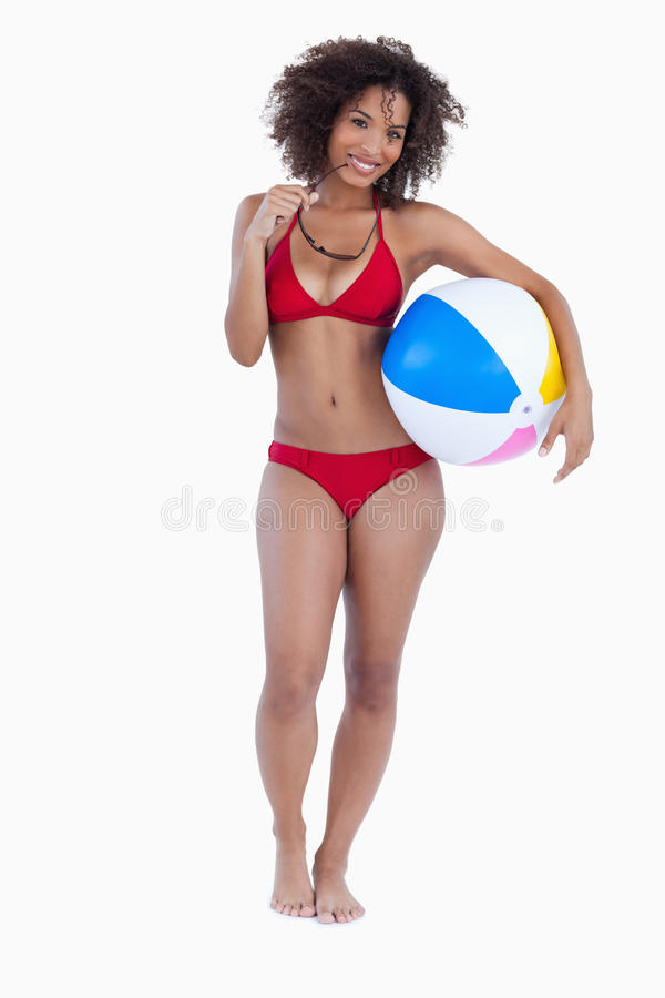 Download Smiling Woman Holding A Beach Ball And Sunglasses Stock Photo - Image: 25334542