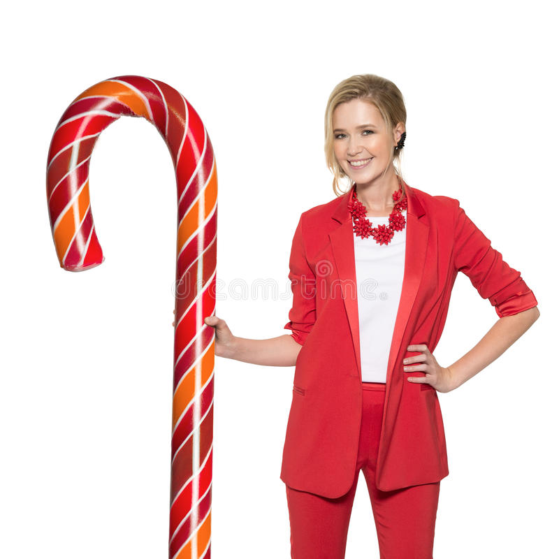 Smiling Woman Holding Big Lollypop. Happy New Year. Merry Christmas. Isolated royalty free stock photography