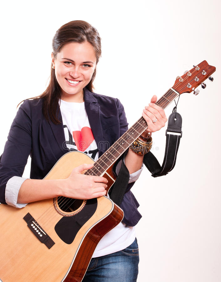 Download Smiling Woman Holding Guitar Stock Photo - Image: 19867488