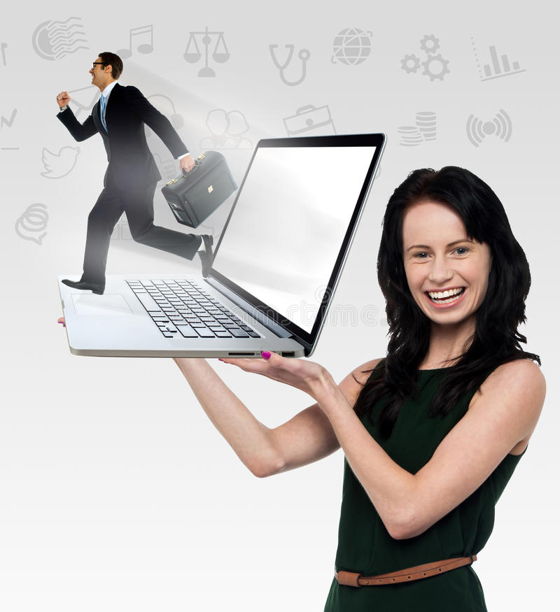 Smiling woman holding laptop royalty free stock photos