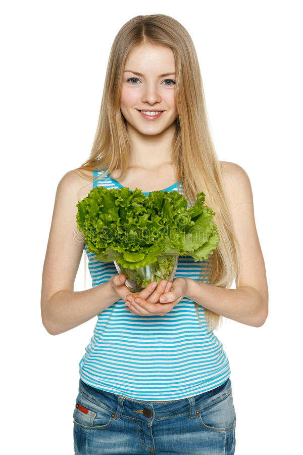 Smiling woman holding lettuce stock photography