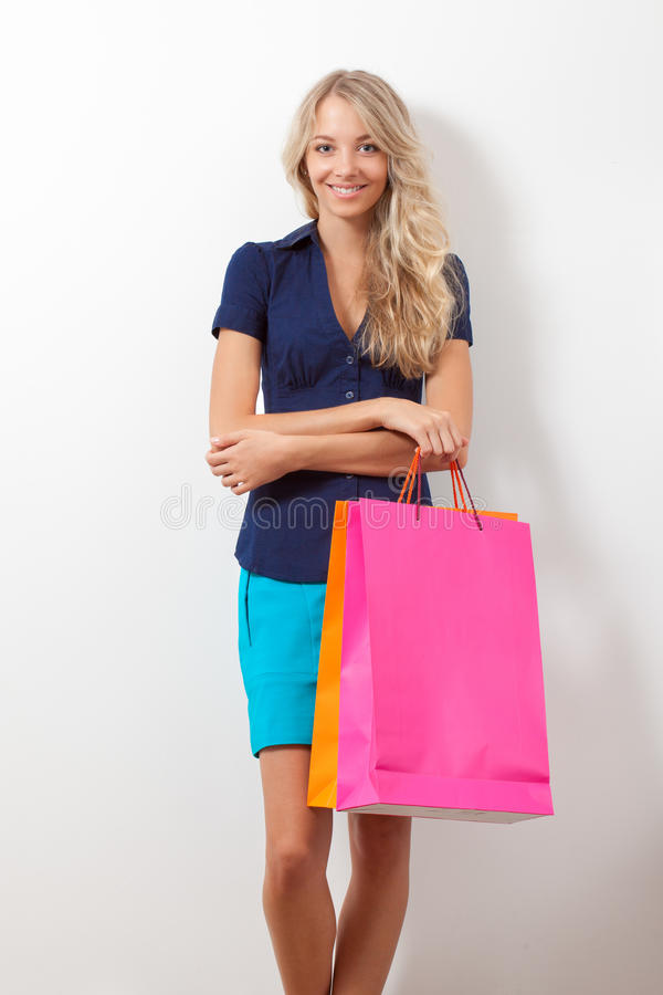 Download Smiling Woman Holding Shopping Bags Stock Image - Image: 25825413