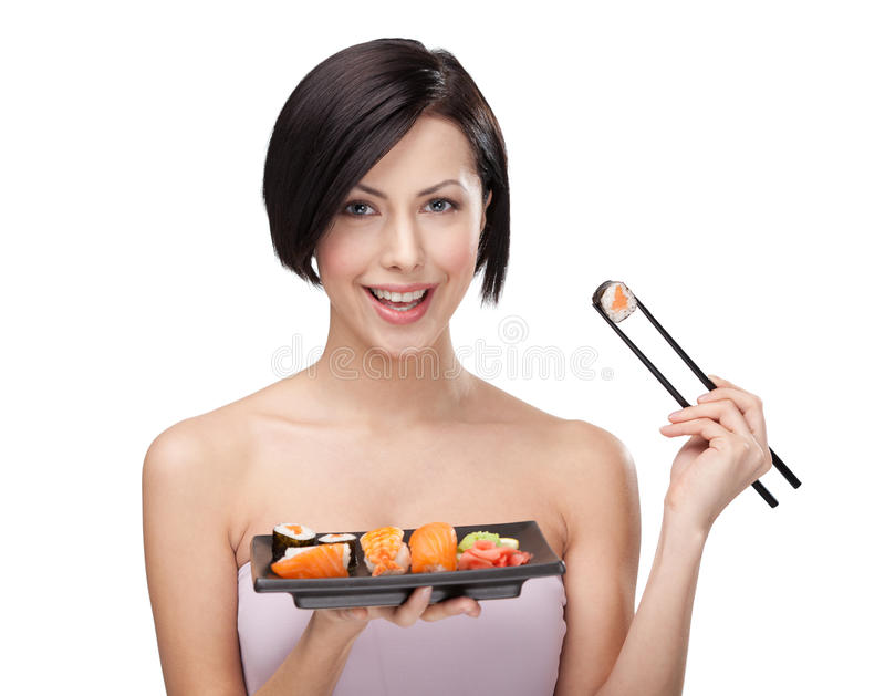 Download Smiling Woman Holding Sushi Roll Stock Image - Image: 24919267