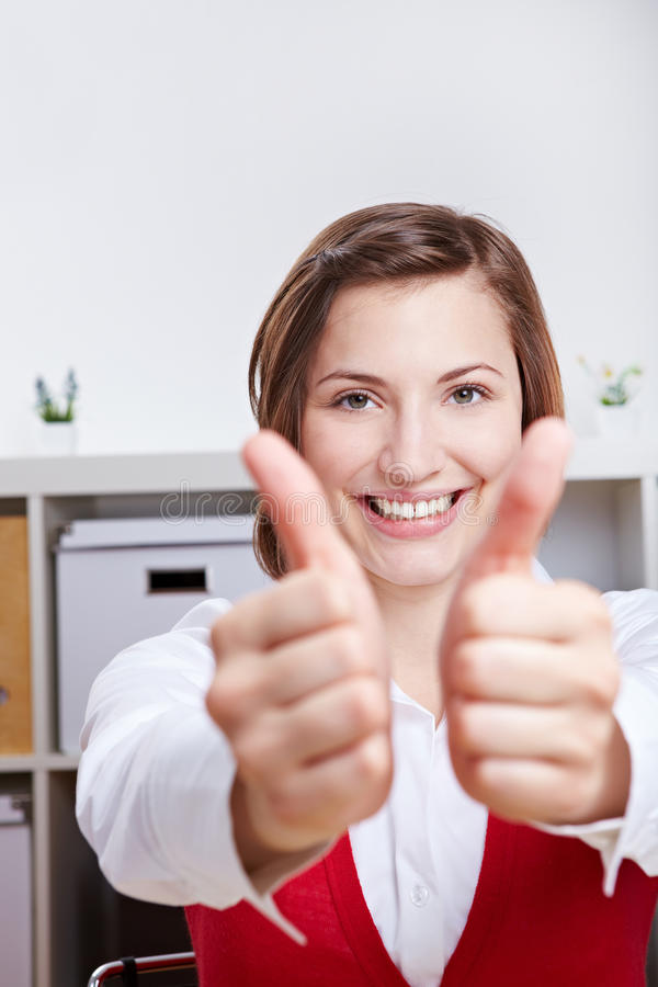 Smiling Woman Holding Two Thumbs Up Stock Photos