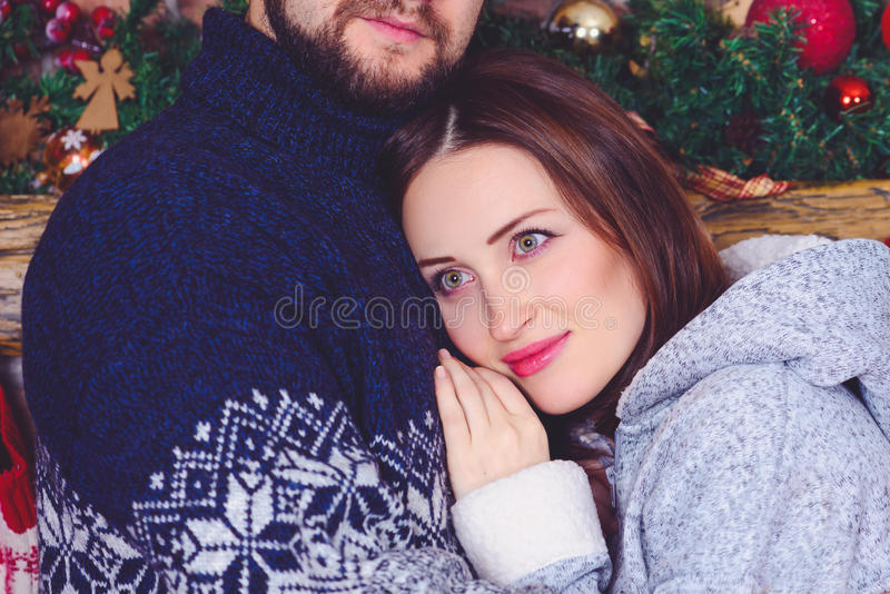 Smiling woman hugging her husband royalty free stock photos