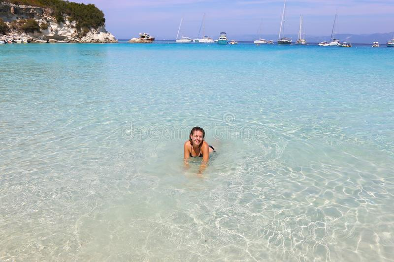 Smiling woman in the Voutoumi beach Antipaxos island Greece royalty free stock images