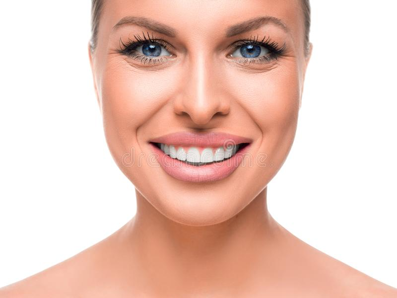 Smiling woman isolaed on white. Tooth whitening. royalty free stock photo