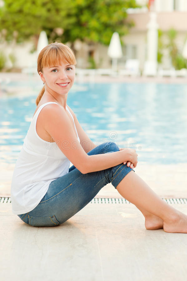 Download Smiling Woman In Jeans Nearby Pool Stock Image - Image: 19583379