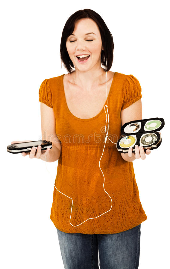 Smiling woman listening media player. Smiling woman listening to music on an media player isolated over white stock photos