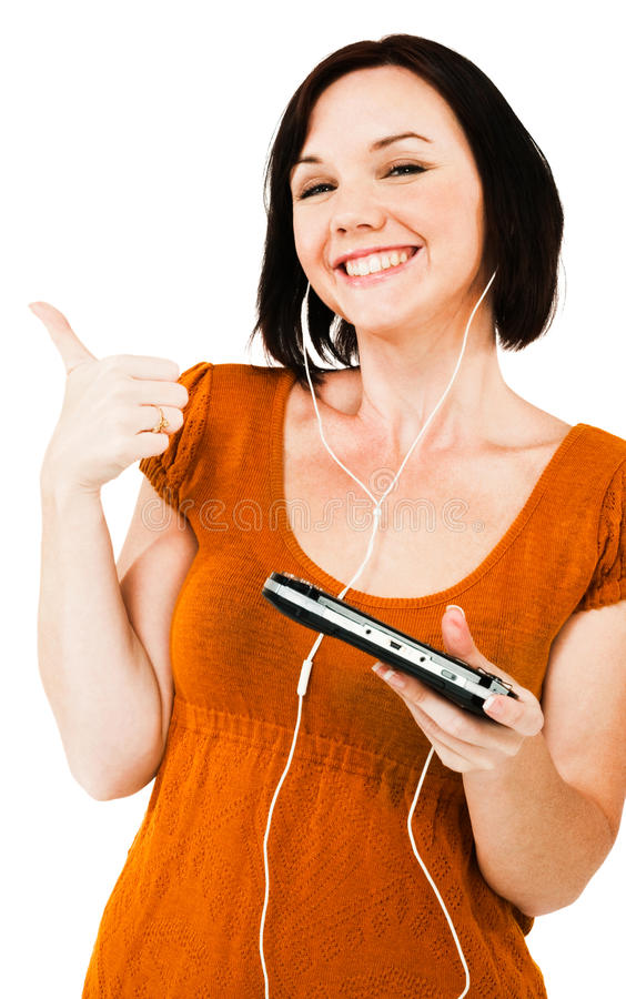 Smiling woman listening media player. Smiling woman listening to music on an media player isolated over white stock photo