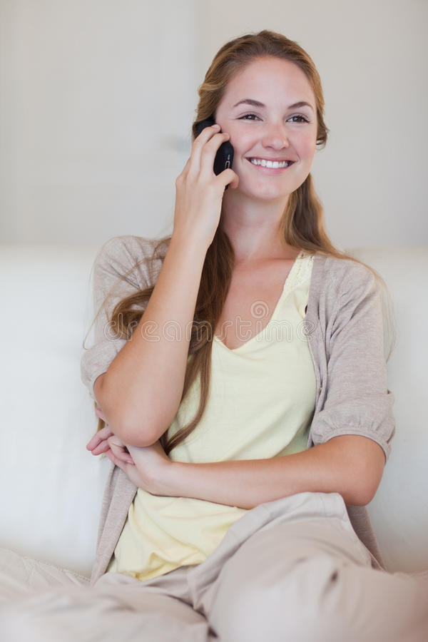 Download Smiling Woman Listening To Caller On Her Cellphone Stock Photo - Image: 22350182
