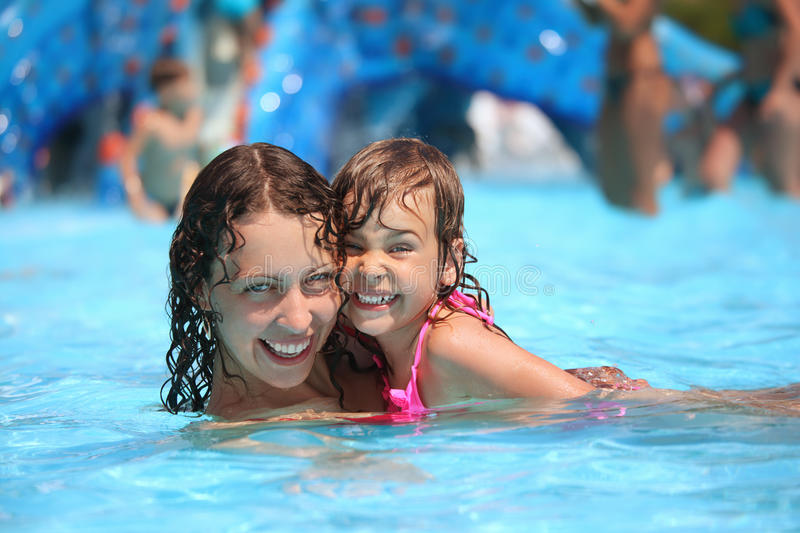 Download Smiling Woman And Little Girl Bathes In Pool Stock Photo - Image of recreational, outdoors: 13021670