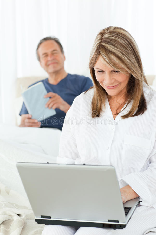 Smiling Woman Looking At Her Laptop Royalty Free Stock Photos