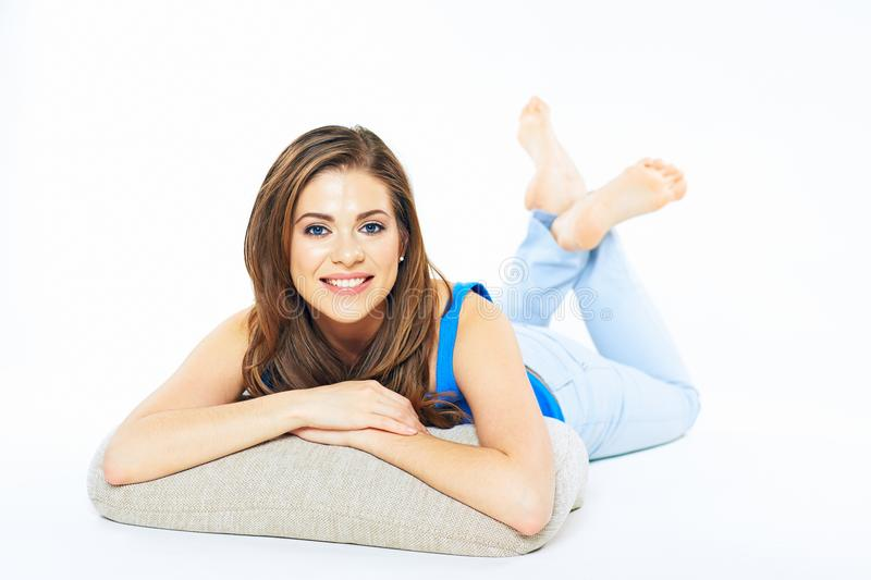 Smiling woman lying on a floor lean on arms. stock images