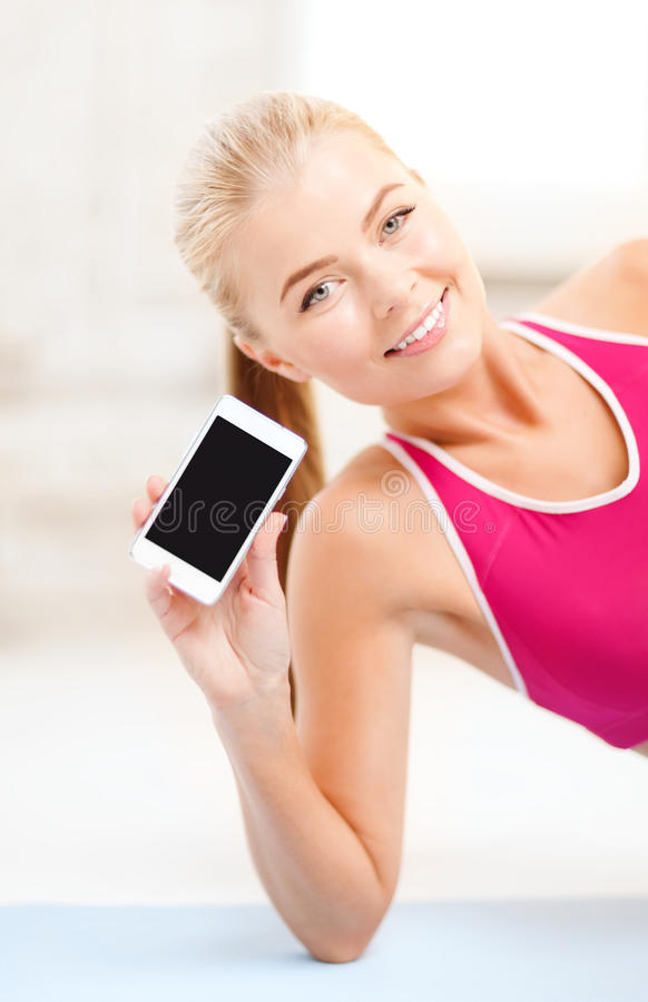 Download Smiling Woman Lying On The Floor With Smartphone Stock Image - Image of beautiful, aerobics: 38574981