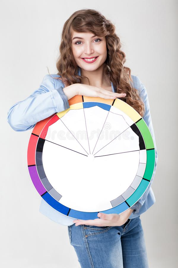 Woman holding color wheel stock photo