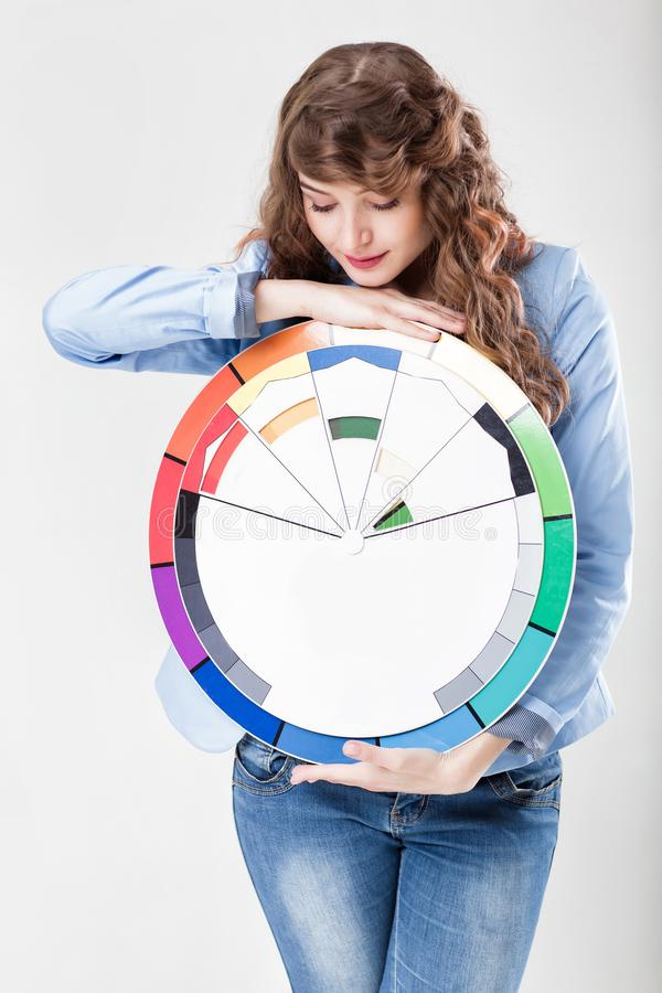 Woman holding color wheel royalty free stock photo