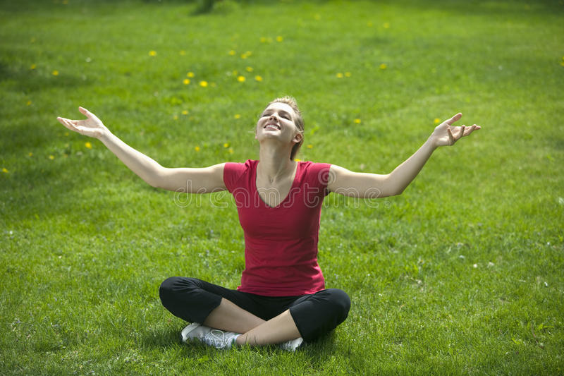 Download Smiling woman meditating stock photo. Image of outdoors - 10575816