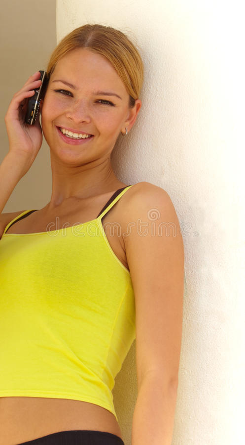 Download Smiling woman with mobile stock image. Image of leans - 10348891