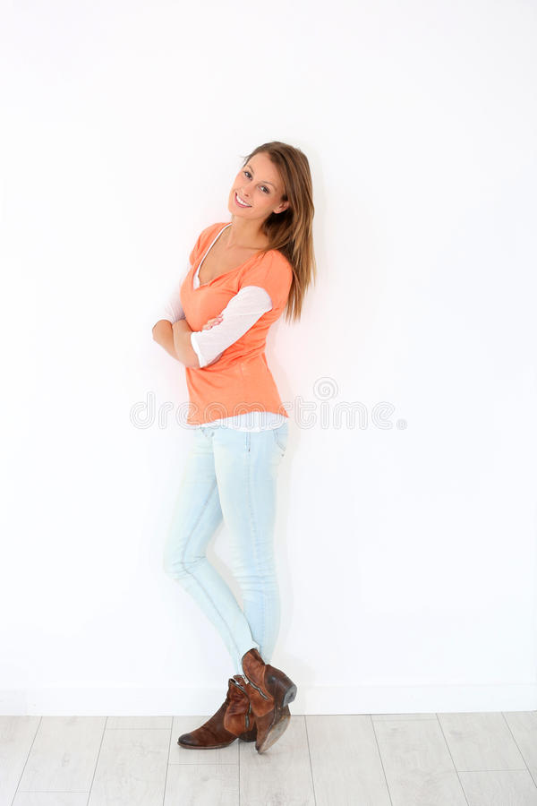 Smiling woman model in spring clothes isolated. Smiling girl with orange shirt, isolated royalty free stock images