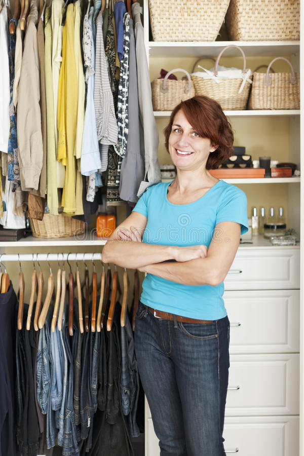 Download Smiling woman near closet stock photo. Image of clothing - 29428468