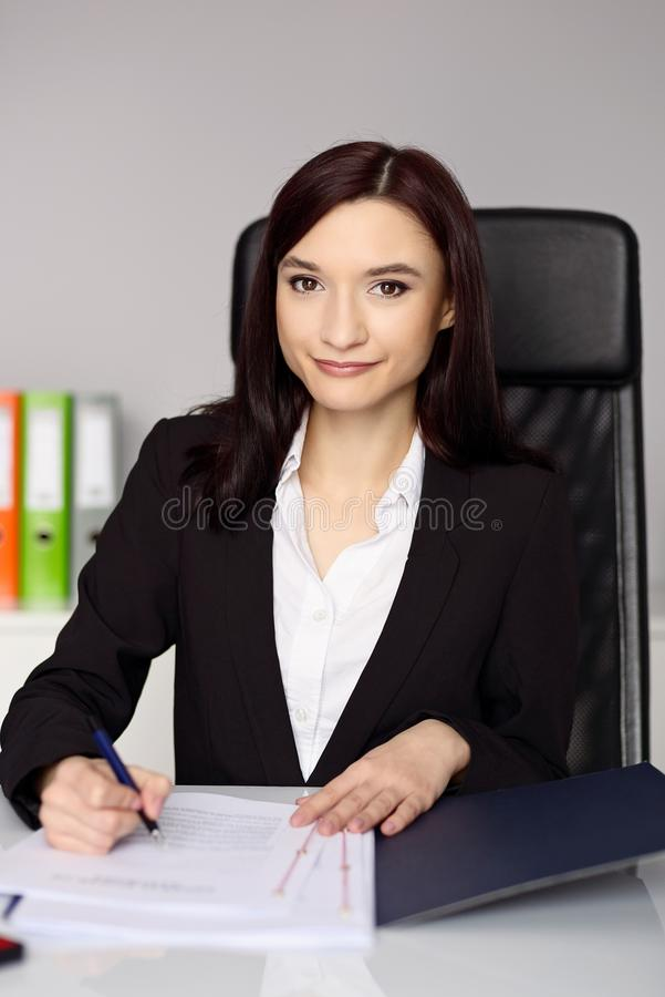 Smiling woman notary public notarizes the power of attorney stock image