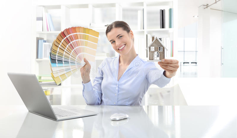 Smiling woman in office, concept architecture and construction stock images