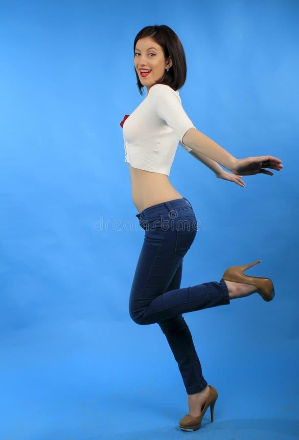 Smiling woman on one leg stock photo