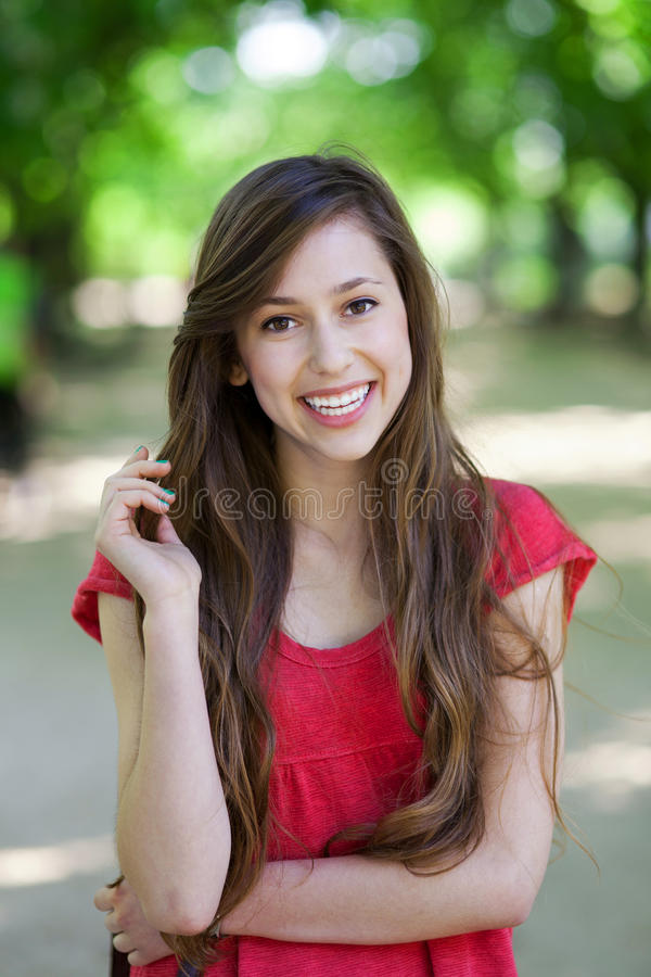 Smiling Woman In Park Stock Image