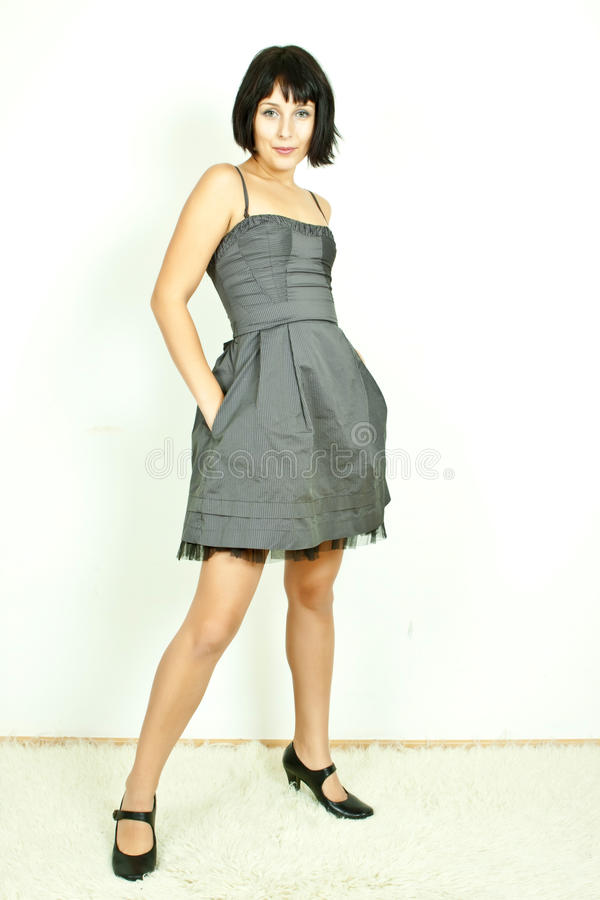 Smiling woman in party dress royalty free stock image
