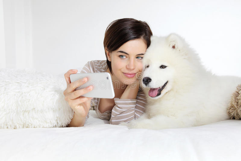 Smiling woman with pet dog. selfie stock photography