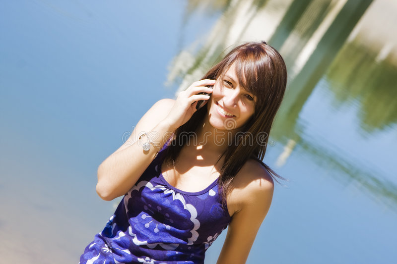 Smiling woman at phone royalty free stock photo