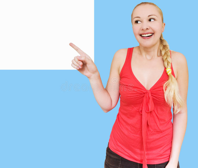 Download Smiling Woman Pointing Towards Copyspace Stock Photo - Image: 10256262