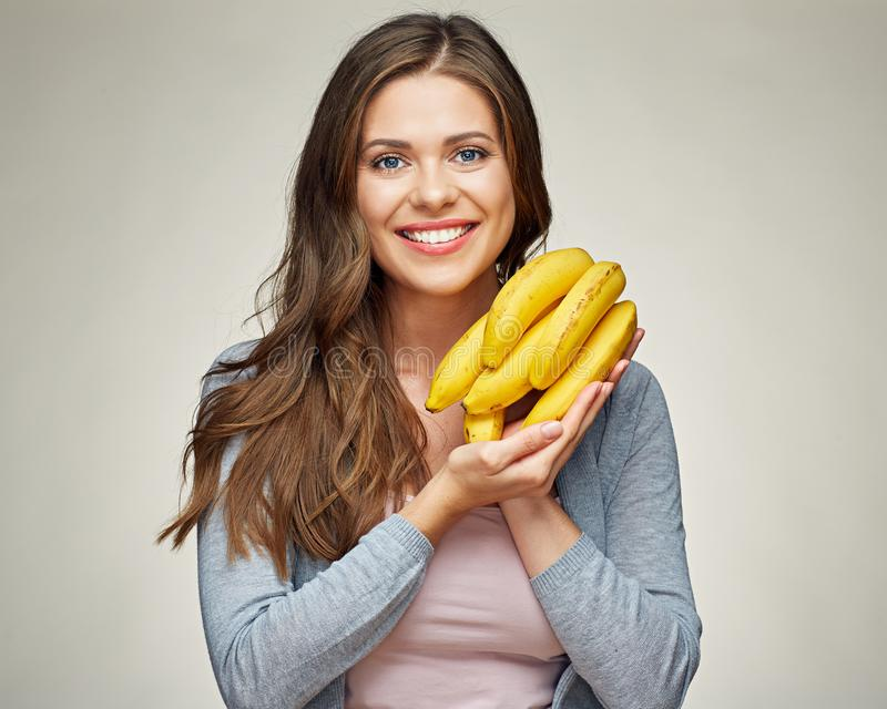 Smiling woman portrait with vitamin diet food banana. Isolated portrait stock photos