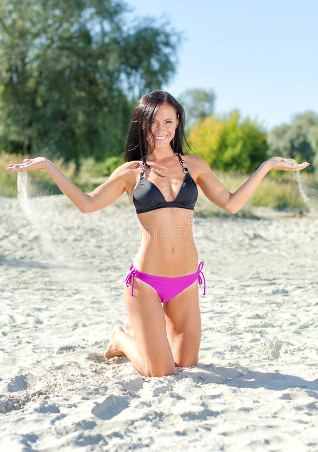 Smiling woman posing. On the beach royalty free stock photo
