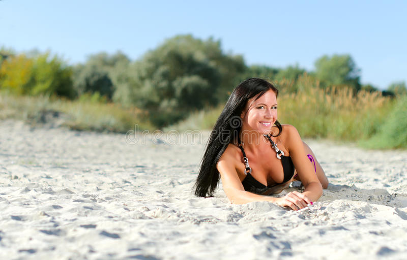 Smiling woman posing. On the beach royalty free stock photography