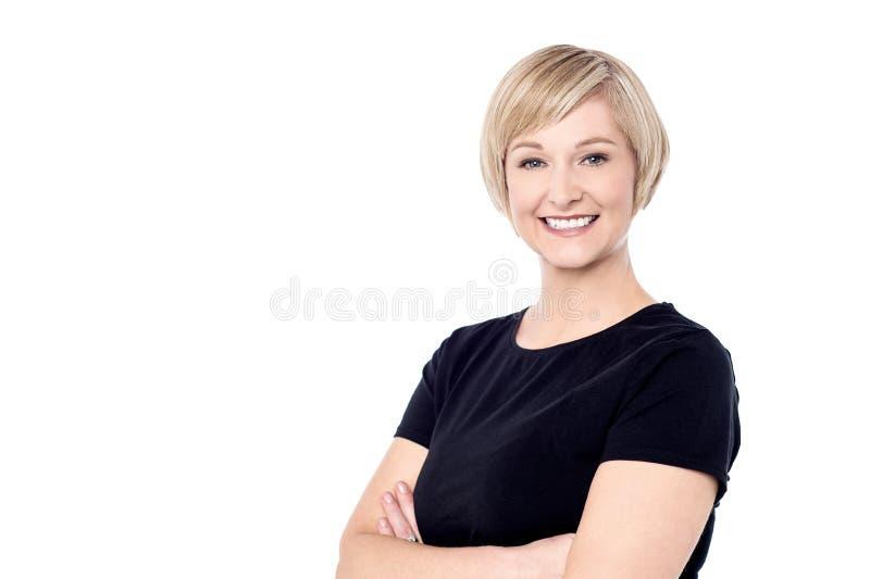 Smiling woman posing casually stock photos
