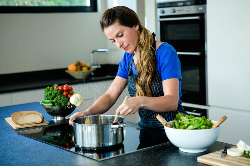 smiling woman preparing vegetables for dinner royalty free stock photography