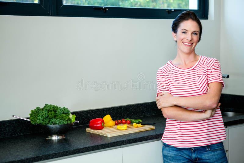 smiling woman preparing vegetables for dinner stock photo