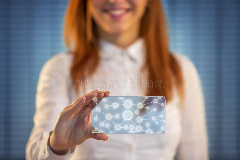 Smiling woman pressing touch screen on social network icon. Smiling business woman holding screen, social network conception royalty free stock image
