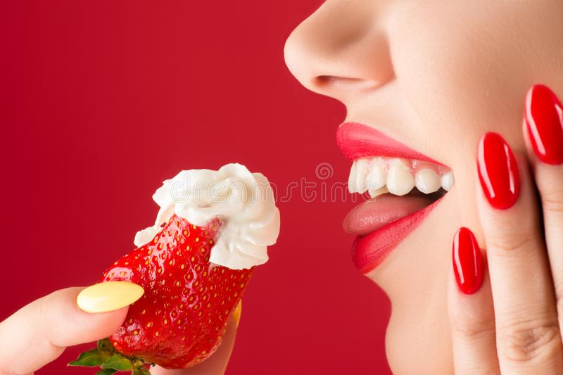 Smiling woman profile face with strawberries in hands royalty free stock photo