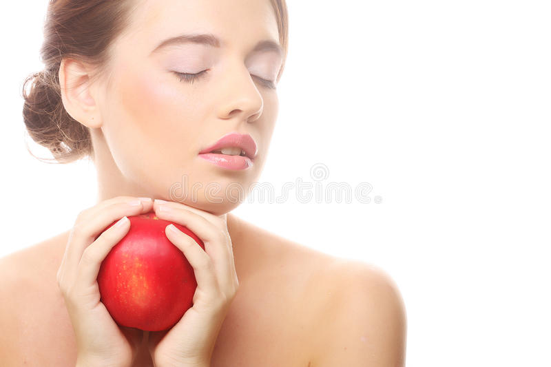 Smiling woman with red apple. Isolated on white stock photo