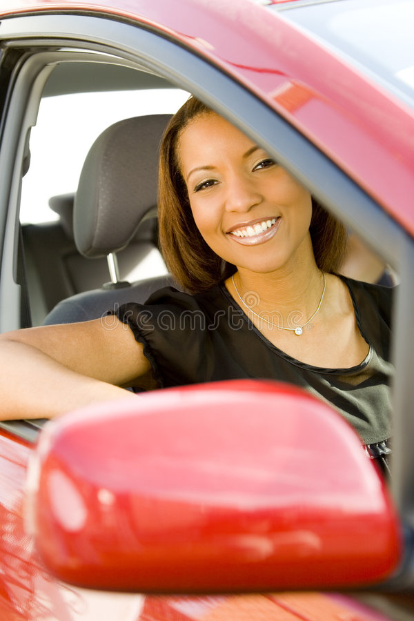 Download Smiling woman in red car stock image. Image of view, vehicle - 5621271