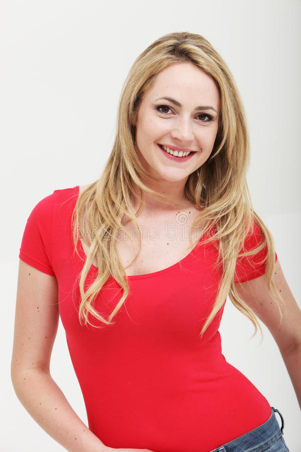 Smiling woman in red shirt stock photo