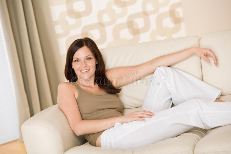 Download Smiling Woman Relax On Sofa In Lounge Stock Photo - Image: 14721332