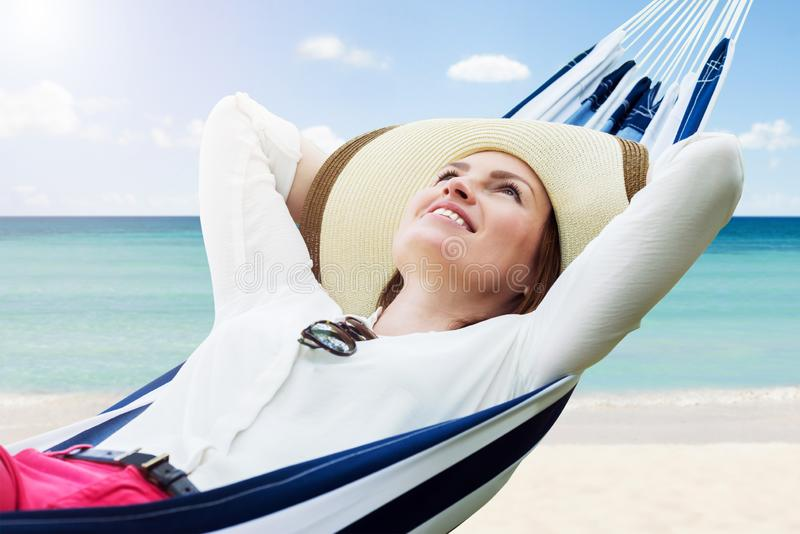 Smiling Woman Relaxing In Hammock stock photo