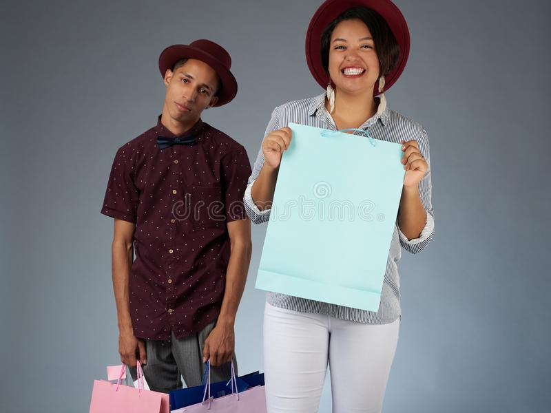 Smiling woman and sad man in shopping royalty free stock photo