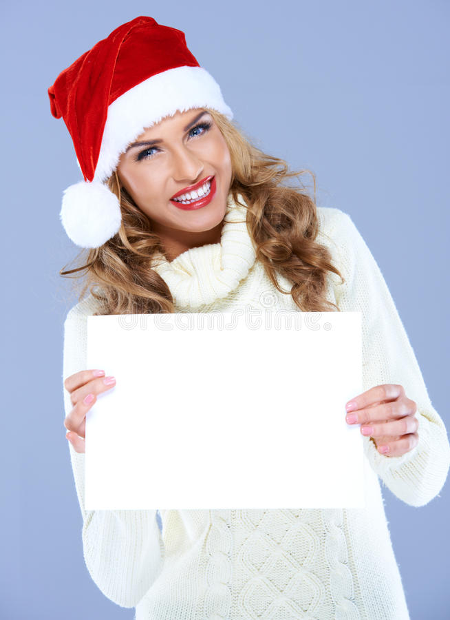 Download Smiling Woman In Santa Hat Holding Blank Board Stock Image - Image: 27142293